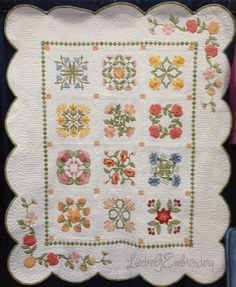 Birth Month Flowers of the Year machine embroidered applique quilt by Lindee Goodall quilted by Nubin Jensen. Designs available from Lindee G Embroidery.