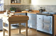 The 3-oven AGA range cooker in duck egg blue. Located in a kitchen setting.