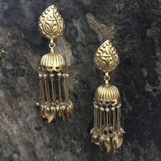 Product Details: Base Material - 92.5 Carat Pure Silver with Gold Plating Technique - Handcrafted Product Type - Temple Jewellery  Design -  Jhumka Length - 7 cm  Width - 3 cm  Care Instructions - Avoid Contact with Perfumes and Water Contact No - +91 8095752326 E-Mail - contactus@madhurya.com   Also available in Pure Gold*  Shipping Worldwide