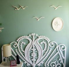 White wicker headboard against a mint green wall. Vintage Seagull decoration on the wall White Headboard, Wicker Headboard, Wall Headboard, Painted Headboard, Wicker Dresser, Wicker Couch, Wicker Trunk, Wicker Bedroom, Wicker Shelf