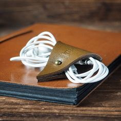 The Cord Holder is constructed out of a single piece of Italian vegetable tanned full grain leather. It gives you easy way for managing your cords. KEEP YOUR HEADPHONES TANGLE-FREE PLUS YOUR DESK CLEA