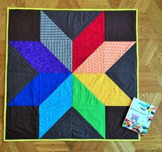 Giant Rainbow Star Quilt - Baby Quilt - Toddler Quilt by ElevenStitches on Etsy https://www.etsy.com/listing/229649525/giant-rainbow-star-quilt-baby-quilt