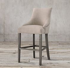 RH's Martine Fabric Stool:Inspired by a French design, Martine is elegant yet comfortable. A curved silhouette and tapered legs lend timeless appeal.