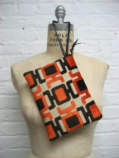 Wristlet clutch in mod orange and brown raised by GirlGeniusGoods, $48.00
