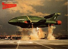 Thunderbird Two - Heavy supersonic VTOL carrier lifting body aircraft used for the transport of major rescue equipment and vehicles, including Thunderbird Thunderbirds Are Go, Retro Rocket, London Airports, Sci Fi Tv Shows, Cult, Cartoon Tv Shows, Collector Cards, Kids Tv, Movie Props