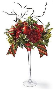 Christmas floral arrangement in cocktail glass. Christmas Flower Arrangements, Christmas Flowers, Christmas Table Decorations, Floral Arrangements, Christmas Holidays, Christmas Wreaths, Christmas Ornaments, Rustic Christmas, Elegant Christmas Centerpieces
