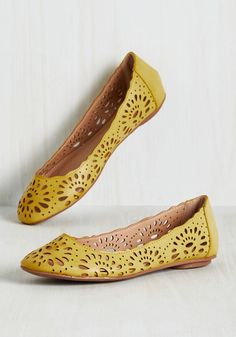 Live in the Momentum Flat in Dandelion. If objects in motion tend to stay in motion, then these goldenrod flats will fit right into your on-the-go lifestyle! #yellow #modcloth