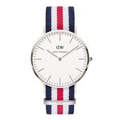 Daniel Wellington horloge  Classic Canterbury DW00100016. Stijlvol horloge met een ultradunne kast van 6 mm. De zilverkleurige kast heeft een doorsnee van 40 mm en is voorzien van een eischelpwitte wijzerplaat. Dit model heeft een rood-wit-blauwe nato band voorzien van een gespsluiting. De modellen uit de classic collection zijn van simpel design met zuivere lijnen en een strakke wijzerplaat.  https://www.timefortrends.nl/horloges/daniel-wellington/heren.html