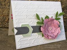 I like this card but maybe not the big flower on it, I like the banner going through the hexagon punched pieces.