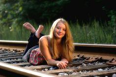 Railroad senior picture ideas for girls. Railroad senior pictures. #railroadseniorpictureideas #railroadseniorpictures #seniorpictureideasforgirls