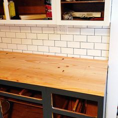 """""""DIY wood plank countertops"""" The wood plank countertops paired with the subway tile looks great! #DIY #HandmadeHome #subwaytile"""