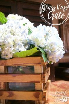 Glass Vase Crate is a glass vase purchased and added farmhouse style with a DIY crate. Farmhouse kitchen decor filled with hydrangeas. | Country Design Style | countrydesignstyle.com
