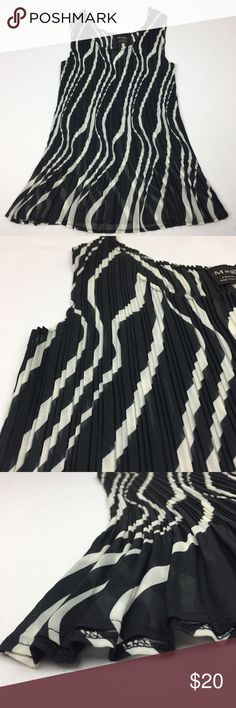 "One Size Fit All Chiffon Pleated Sleeveless Blouse Black and white tank top blouse. Brand Magic ItFits by The Magic Scarf Company! It REALLY stretches to fit many sizes but also has a nice fitted design. Nice swirl pattern and transparent material. Semi rounded  hemline. New with tags and never used. Any flaws shown in photos. ⚠️PLEASE select ""ONE SIZE"" when checking out, thank you!⚠️ Offers always welcome✔️Bundle for cheaper✔️ the magic scarf company Tops Blouses"