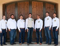 This is the best picture I could find. Groomsmen in brown boots, dark wash blue jeans, gray dress shirts, and dark purple ties. Cody in the same but with a vest too.