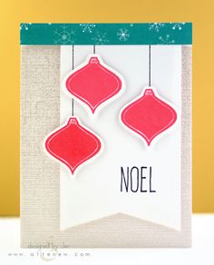 On this card, three ornaments were stamped in dark pink ink, then cut out before getting adhered to a white cardstock banner.