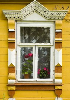 yellow house in Russia with fabulous windows and lace curtains....