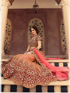 Buy Designer Bridal Lehengas, Wedding Lehengas Online : Create an impeccable look wearing this pink and maroon net and velvet unstitched lehenga choli featuring intricate zari work. Paired with a matching dupatta. It can be customized upto size 42. *Call / Whatsapp / Viber : +91-9052526627 *Email : customercare@natashacouture.com *Worldwide Shipping | Free shipping in India | Cash on delivery *