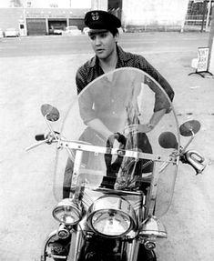Elvis Presley sits on a 'Harley'