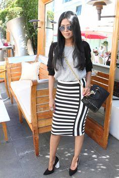 Sheryl from Walk in Wonderland in a bebe striped skirt