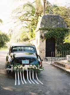 Weddbook ♥ Elegant decoration for wedding car. This black color car is beautifully decorated by white color flowers along with leaves and white lace. Car will look so beautiful and perfect to take your girl after wedding in the lovely decorated car Marie's Wedding, Wedding Exits, Garden Wedding, Wedding Blog, Dream Wedding, Wedding Cars, Wedding Ideas, Wedding Things, Elegant Wedding