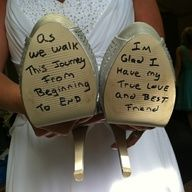 The groom surprises the bride by writing a letter on the bottom of her shoes