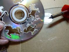 Cut with a soldering iron? Make it easy crafts: Recycled CD landscape brooch