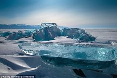 Lake Baikal, Siberia - These majestic and beautiful transparent, turquoise masses of broken ice are caused by the unequal structure, temperature and pressure in the main body of the packed ice. Giant ice blocks, also called ice hummocks, form through movement of ice flow, extreme winds and cold temperatures can reach a height of 15m