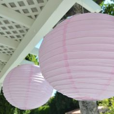 """16-inch Asian Style Round Paper Lanterns - Pink (2 Per Pack) by Party N Beyond. $6.95. Includes bendable metal frame that expands the lantern. Metal frame includes hook that accommodates most light cords. 16"""" size in diameter. Minimal assembly required. Made with fine quality paper and parallel metallic ribbing. Planning an Asian style wedding?  Trying to dazzle your friends with a private event?  Litter the sky with dozens of these round paper lanterns to create..."""