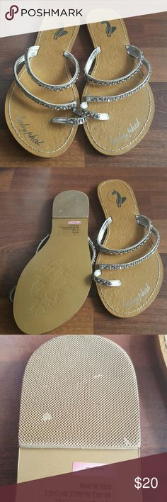 Baby Phat Silver sparkle sandals Two strapped with big toe strap. They are super cute on and look great for a casual or dressy affair. Worn once or twice. Baby Phat Shoes Sandals