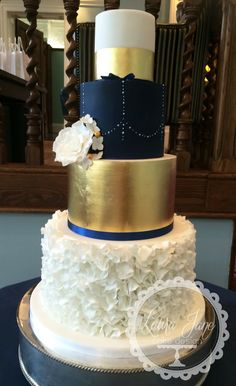 Navy and gold wedding cake                                                                                                                                                                                 More