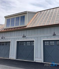 Custom wooden garage doors, crafted from Red Grandis, create a traditional carriage house look for these homeowners. The doors were painted by the custom builder after the installation and they look amazing with a traditional, barn-inspired style. Faux Wood Garage Door, Carriage House Garage Doors, Door Ideas, Houzz, Great Photos, Creative Design, Farmhouse, Traditional, Outdoor Decor