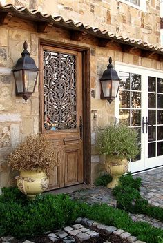 Beautiful Stone Home with Wood Door and Ironwork Window Cover