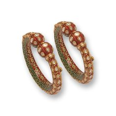 This unique pair of bangles is crafted in 18 K gold and set with uncut diamonds. Rich enamelling in red and green adds to the design feature.