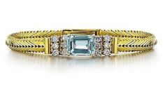 """A stunning Cartier bracelet is center set with a 4.25 carat Emerald Cut Aquamarine flanked by 6 Diamonds on each side totaling approximately 1 carat.  This bracelet combines the red gold, so popular in the 40's with classic yellow gold. It is 6.5"""" long in the closed position with a watch style fold over clasp.  A beautifully feminine bracelet while retaining the very clean lines that is signature to the 40's. Cartier Bracelet, Aquamarine Bracelet, 1 Carat, Emerald Cut, Clean Lines, Red Gold, Diamonds, Feminine, Jewels"""