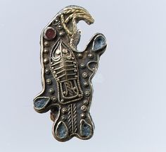 Bird-Shaped Brooch Date: second half 6th century Culture: Frankish Medium: Gold sheet with filigree and granulation and inlays of garnet and glass