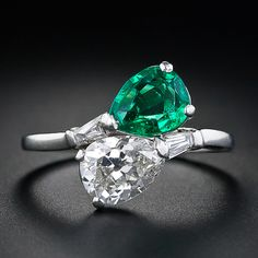 The two main gemstones in this beautiful diamond and emerald bypass ring harken back to the Edwardian period, but the ring itself was most likely remade in the in platinum. The carat antique pear shaped diamond sparkles cheek-to-cheek next to I Love Jewelry, Jewelry Rings, Fine Jewelry, Jewelry Design, Jewellery, Emerald Jewelry, Diamond Jewelry, Aquamarine Necklace, Emerald Rings