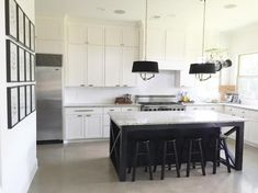 Builder basic home done smart and classy; nice hardware and lighting pack a powerful punch