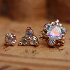 """A stunning trio of studs for a very lucky lady. Rose gold and mercury mist topaz """"Helana,"""" """"Tri-Prong,"""" and prong solitaire ends from @bvla. #goldslinger #appmember #rosegoldsf #safepiercing #sanfrancisco #bvla #bodyvisionlosangeles #gold #goldforeverybody #fashion #finejewelry #classyclients"""