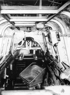 Inside the cockpit of a Messerschmitt Bf 110C-1 looking aft, over the back of…