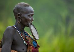 Waist Up Portrait Of A Suri Tribe Woman With A Lip Plate, Kibish, Omo Valley, Ethiopia