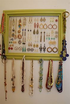THIS is likely the one I will do.  Except no S-hooks, bracelets on the sides and more hooks (drawer knobs???) along the bottom for necklaces.