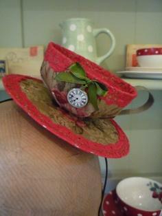 Wonderland TEA CUP FASCINATOR - 'Jacquard Flower', handmade, with pocketwatch charm. £25.00, via Etsy.