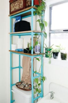 These are some ideas of how to make DIY furniture of pipe shelves to get an industrial design touch. Diy Pipe Shelves, Toilet Shelves, Bathroom Shelves, Bathroom Hacks, Small Bathroom, Bathrooms, Bathroom Marble, Bathroom Ideas, Over Toilet Storage