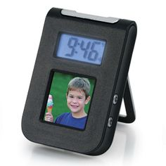 @ShopAndThinkBig.com - The Gear Head 1.5 Digital Photo Frame Travel Alarm Clock Lets You Take The Time, An Alarm, And Your Favorite Pictures With You When You're Away From Home. Featuring A 1.5 Bright Color Display, The Digital Picture Viewer Stores Up To 50 Color Photos You Can View Anywhere. The Illuminated Clock Helps You Keep Track Of Time And It Includes An Alarm With A Convenient Snooze Button For When You Need A Few More Minutes Of Rest. Powered Via Your Computer's Usb Port (Cable…