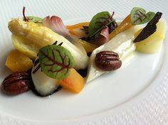 Glazed white asparagus, yellow cling peaches, Belgian endive, Pearson Farm's pecans, sorrel and Australian black winter truffle.