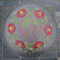 "stefanie-bean:  Japanese manhole cover. Such a contrast to the USA, where pretty much everything ""public"" is inadvertently or even deliberately ugly."