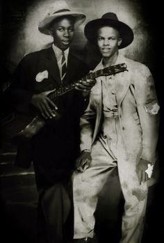 Blues singer Robert Johnson (left) - 'the Grandfather of Rock and Roll'