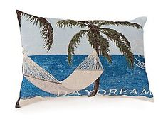 A decorative pillow with a hammock and palm tree design invigorates the look of any room. This pillow is made of a polyester blend and measures 18x12. Spot clean only.