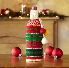 HANDKNIT HOLIDAY BOTTLE SWEATERS -- Heartfelt hostess gift, each of our clever cover-ups, hand knitted of Bosnian wool in festive colors and designs, carries the name of the woman who made it. Made in Bosnia Herzegovina. Exclusive.