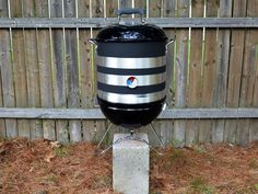 How to build a backyard bbq smoker out of a small Webber grill and a 32 quart stock pot.
